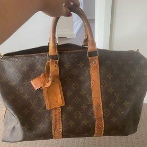 Louise Vuitton travel bag AUTHENTIC